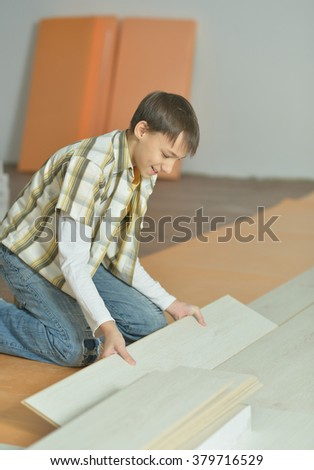 little boy  repairing in the room