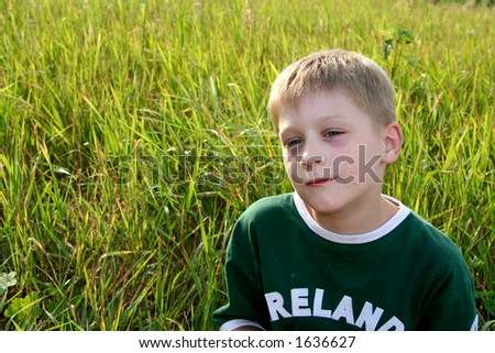 Little boy resting on the grass