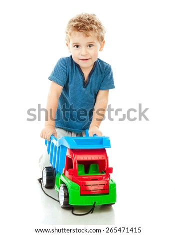 little boy riding a car isolated on white - stock photo