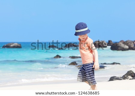 little boy running at the tropical beach - stock photo