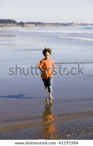 Little Boy Running Barefoot on The Sand at the Beach