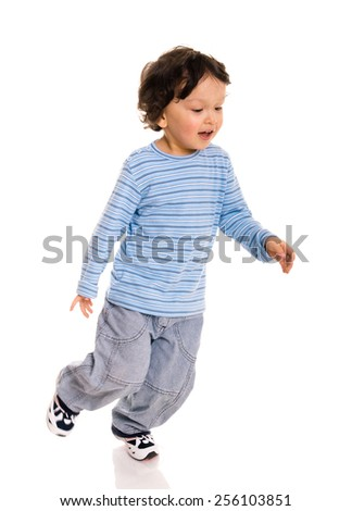 Little boy running on white. - stock photo