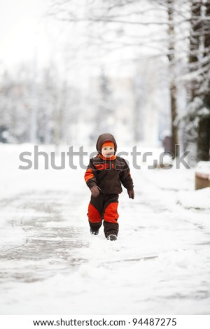 little boy runs in park - stock photo