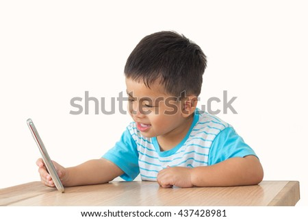 little boy selfie on wooden table and white background,