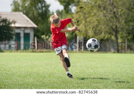 Little Boy Shooting at Goal - stock photo