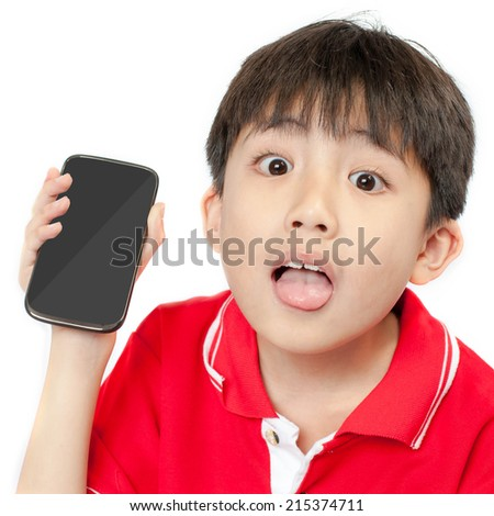 little boy showing a smartphone with fun face. - stock photo