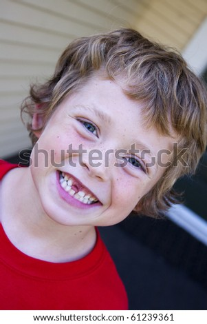 little boy showing off his lost tooth - stock photo