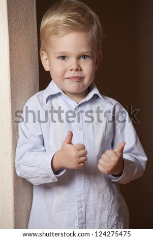 Little boy showing thumbs up gesture - stock photo