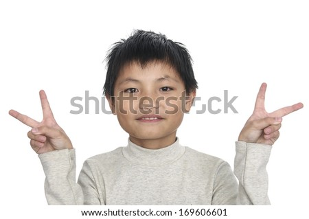 little boy showing victory gesture  - stock photo