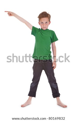 little boy shows something above him - stock photo