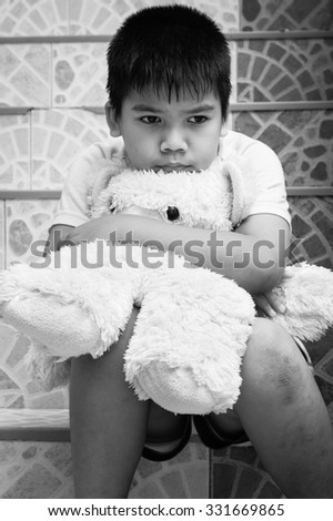 little boy sitting alone at staircase in the park,black and white tone - stock photo
