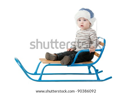 little boy sitting in a sleigh