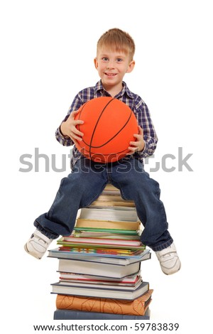 little boy sitting on books with basketball ball isolated a white background