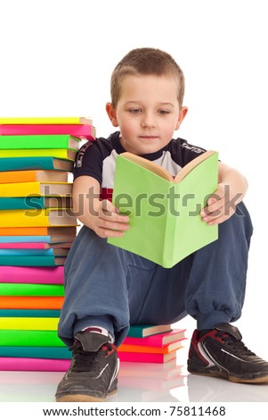 little boy sitting on books with white background, front view - stock photo