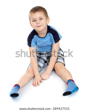 Little boy sitting on the floor -Isolated on white background