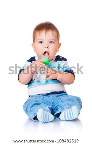 Little boy sitting with a bottle