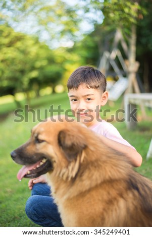 Little boy sitting with dog friendship - stock photo