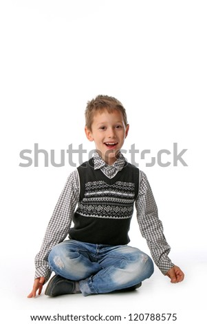 Little boy sitting with smile on face