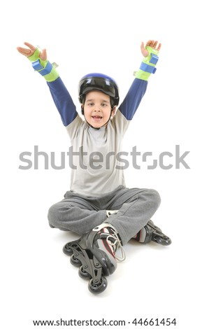 Little boy skater wearing helmet giving victory up sign while resting on the floor. White background studio image. - stock photo