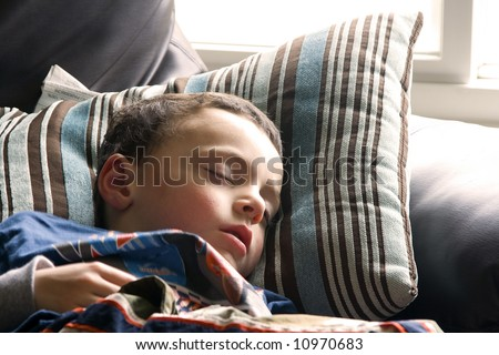 Little Boy Sleeping on the Couch