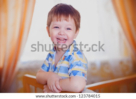 little boy smiles and happy