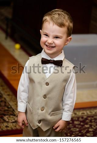Little boy smiling - wedding ring bearer - stock photo