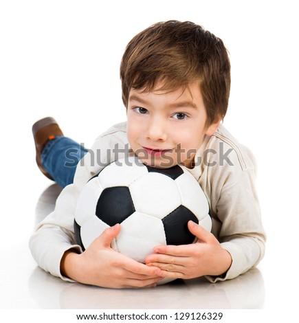 Little boy soccer ball lying on white floor - stock photo