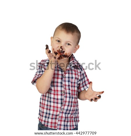 Little boy soiled in chocolate licks fingers isolated on white background in square