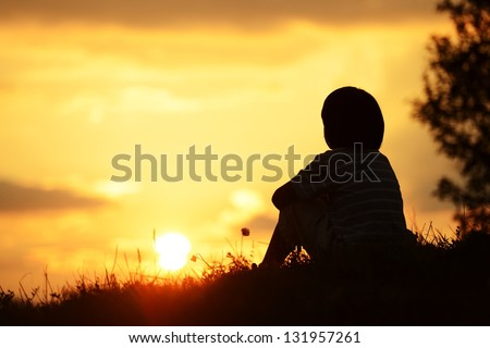 Little boy spending happy time on summer nature - stock photo