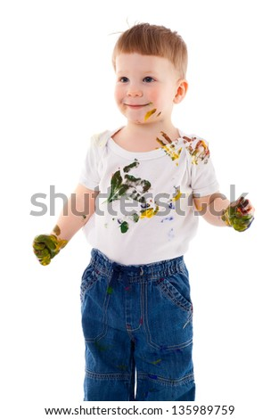 little boy stained in paint, isolated on white - stock photo