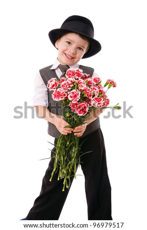 Little boy standing with a bouquet of pink carnations, isolated on white - stock photo