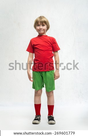 Little boy stands in sport form - stock photo