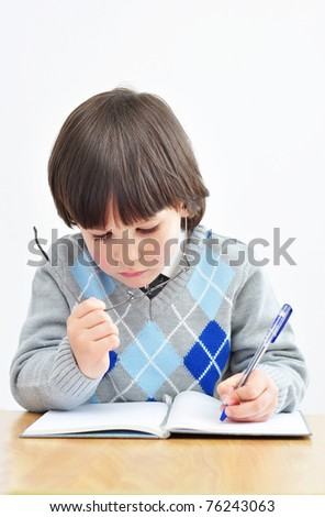 Little boy studying - stock photo
