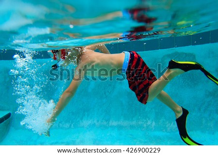 little boy swimming underwater, active kids - stock photo