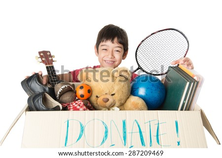 Little boy taking Donation box full with stuff  for donate - stock photo