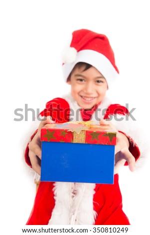 Little boy taking giving present on christmas - stock photo