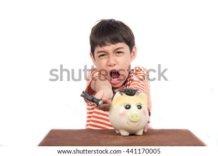 Little boy taking hammer trying to broke piggy bank