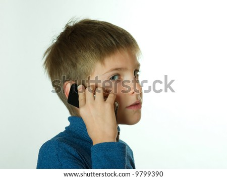 little boy talking by cell phone