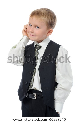 Little boy talking on the phone. Isolated on white background