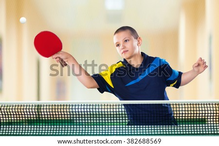 Little boy tennis-player in play. Action shot. - stock photo