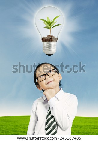Little boy thinking about ecological concept - stock photo