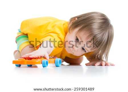 little boy toddler playing with toy car isolated - stock photo
