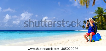 little boy travel on summer tropical beach with suitcase and binoculars, wide panorama - stock photo