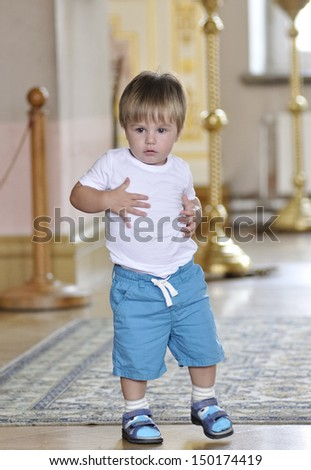 Little boy tries to make dancing movement - stock photo