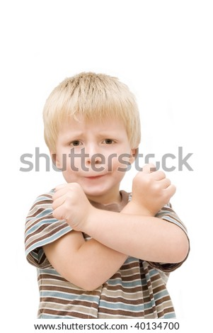 Little boy trying to look tough. - stock photo