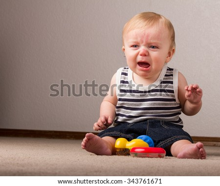 Little boy unhappy and letting his voice be heard - stock photo