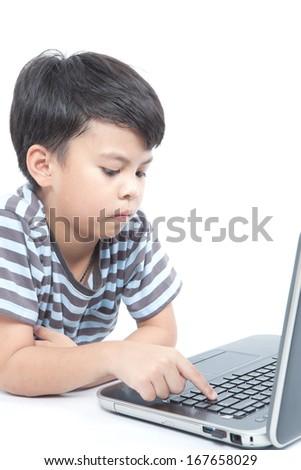 Little boy using laptop studio shot. - stock photo