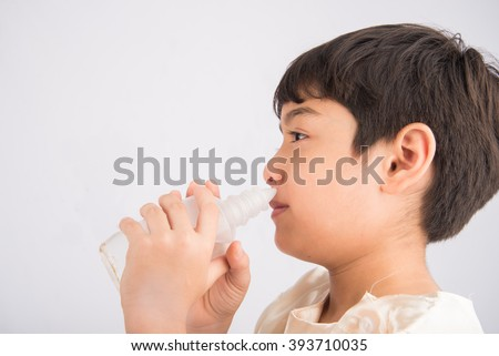 Little boy using salt water to clean his nose