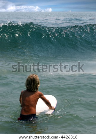 Little boy waiting for the wave on Malibu Beach, California - stock photo