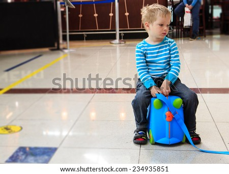 little boy waiting in the airport, child travel - stock photo